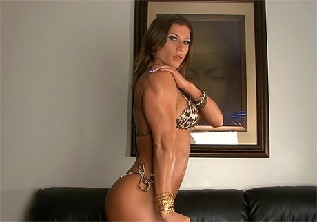 Sexy Fitness Goddess with strong muscles posing and flexing