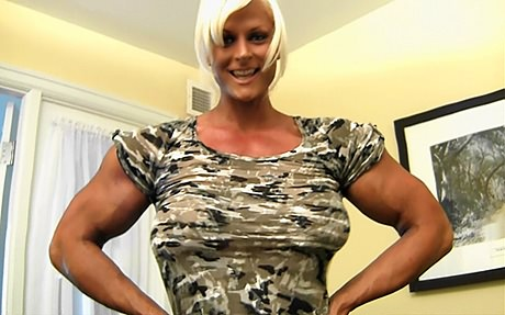 Free Video 2. Massive Muscular Amazon flexing her 18 inch biceps