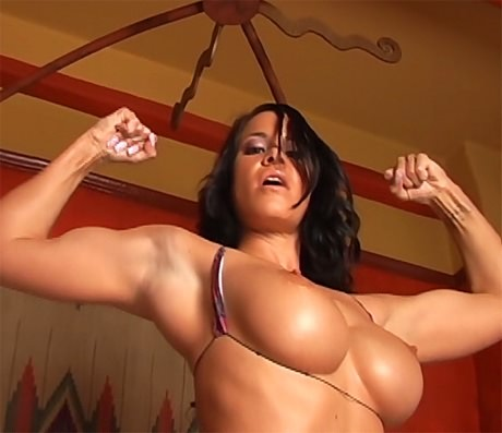 Sexy busty Fitness brunette flexing her biceps from wonderful katie morgan